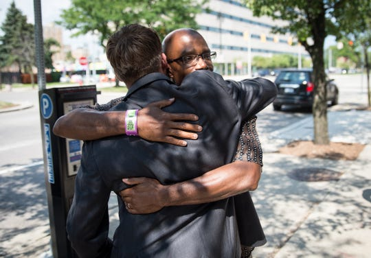 Darrell Siggers hugs his attorney, Mike Waldo, on Grand Boulevard in Detroit after being released from the William Dickerson Detention Facility on Aug. 10, 2018. Siggers served 34 years for a murder he said he didn't commit.