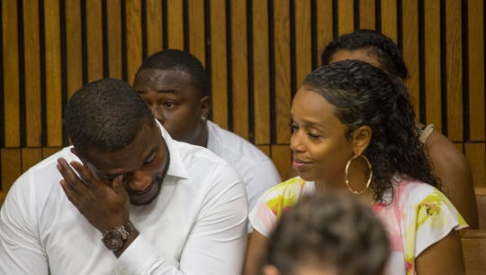 Darrell Arnold, son of Darrell Siggers, wipes a tear during a bond hearing for his father in the Frank Murphy Hall of Justice on Friday, August 10, 2018.