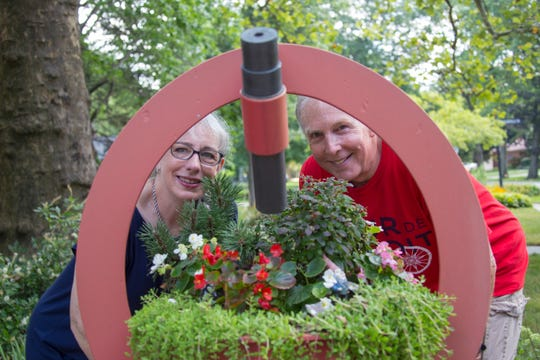 Catherine Robertson, left, with her husband, John, with their life- size kaleidoscope made by Robert Anderson at their home in Lathrup Village. Some of the most creative lawn art exists in the metro Detroit area. We visit a house in Lathrup Village that has a large functioning kaleidoscope and yard in Ferndale that has a giant dragon guarding the corner of Livernois and W. Breckenridge Ave Monday, August 13, 2018.