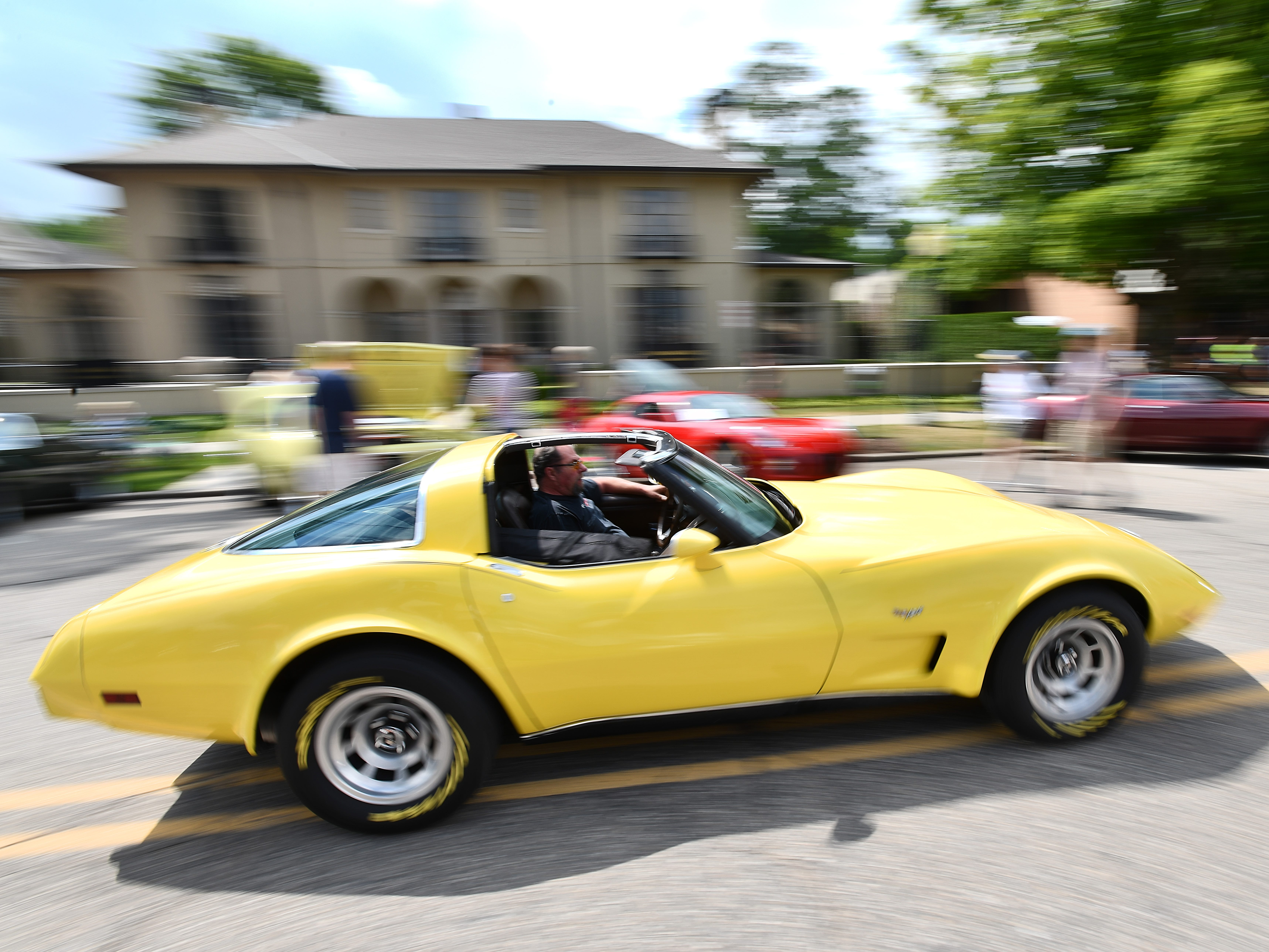 A Corvette glides down Walnut Boulevard during the 19th annual Rockin Rods n' Rochester.