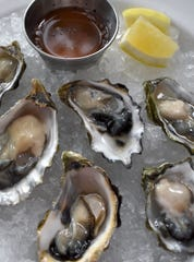 Cozy neighborhood restaurant Craft Work served oysters and other shareable dishes.