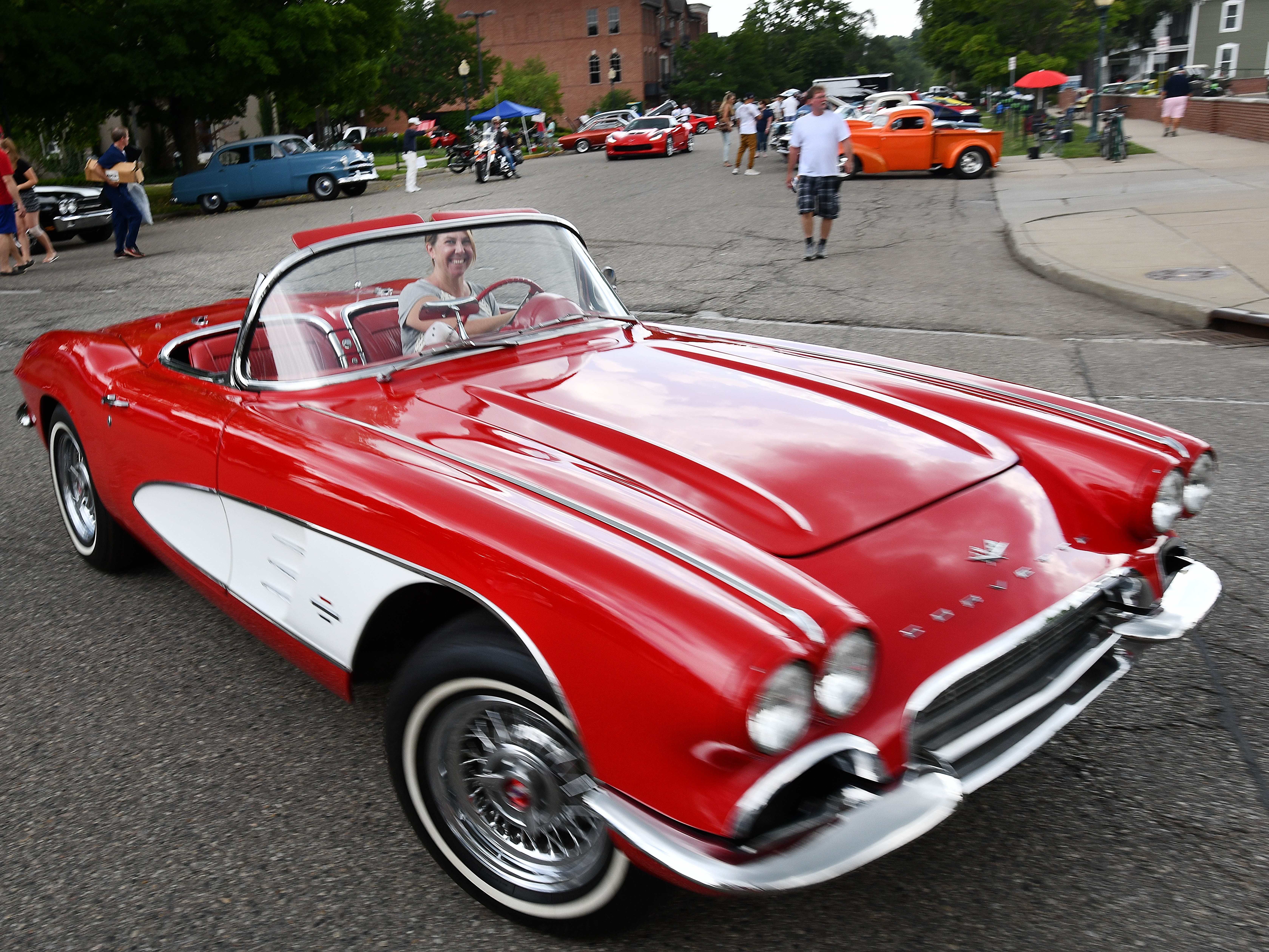 A little red Corvette cruises through the 19th annual Rockin Rods n' Rochester.