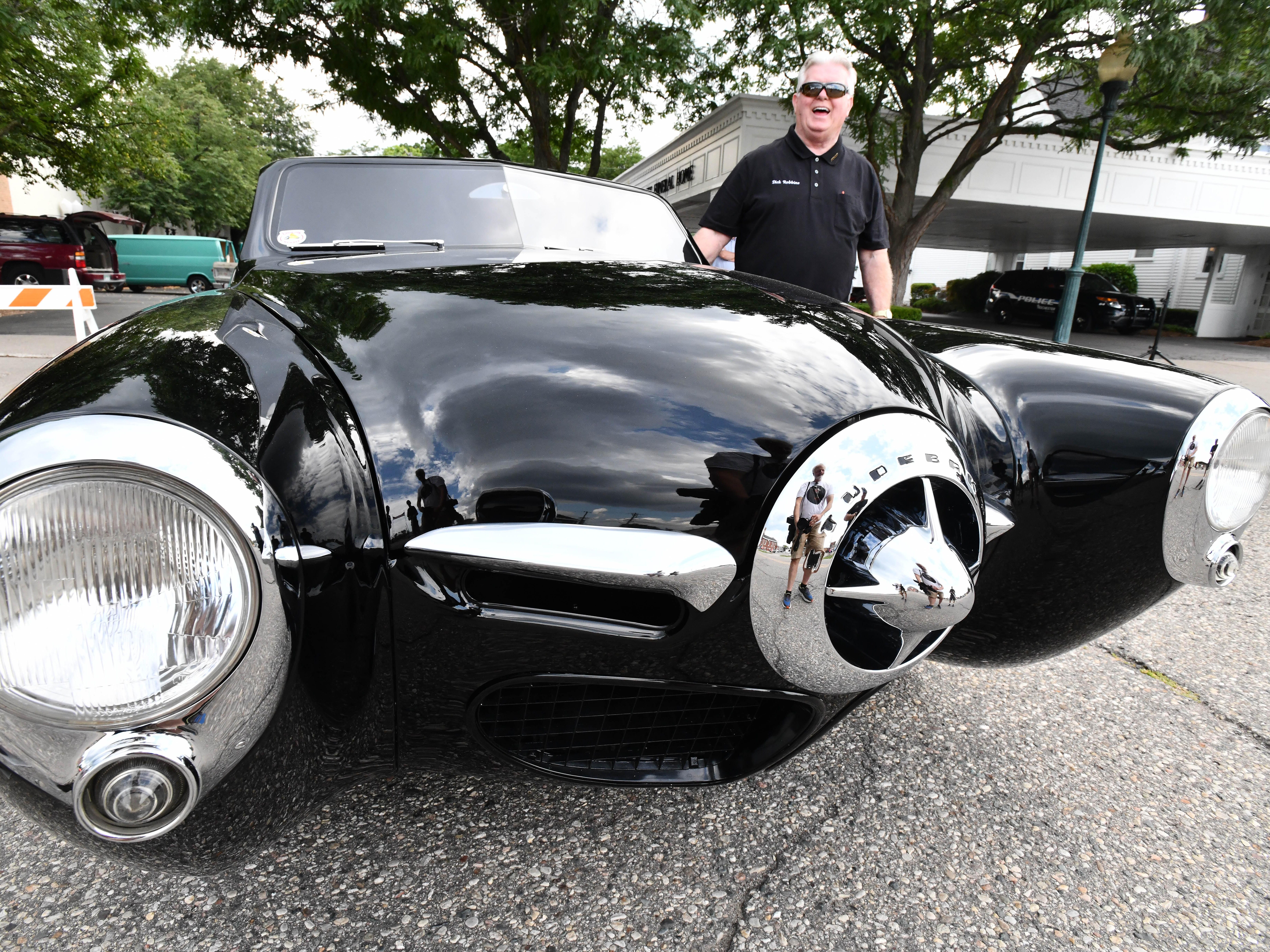 """Dick Robbins with the 19th annual Rockin Rods n' Rochester 'Best of Show' 1947 Studebaker named """"Black Bart""""  at the 19th annual Rockin Rods n' Rochester in Rochester, Michigan on August 12, 2018."""