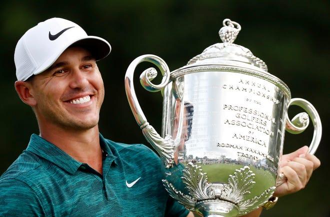 Brooks Koepka holds the Wanamaker Trophy after winning the PGA Championship on Sunday.