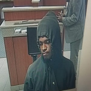 Police say the suspect should be considered armed and dangerous, and ask anyone who has information on the bank robbery to share what they know at 586-447-4483.