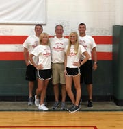 Tyra Buss is pictured with her parents and brothers at her recent skills camp at Evansville Basketball Academy.