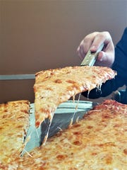 A Lombardi's New York cheese pizza. Chef Frank Laudino even imports gallons of New York City city water to give the crust exactly the right mineral content and flavor.