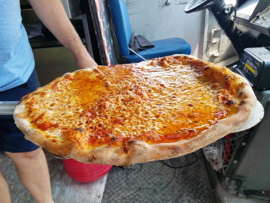 A New York Pie right out of Franco Maninno's oven, with a bubbly edge holding in the wet, smooth sauce and melty full-fat mozzarella cheese. New York pizzas can have all kinds of neat toppings, but it boils down to the crust, sauce and cheese.