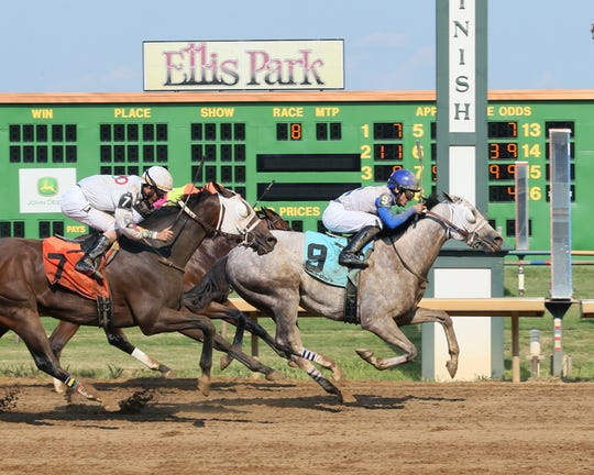 Believe In Royalty, with Gabriel Saez up, edges stablemate Kowboy Karma (7) to take the Ellis Park Derby.