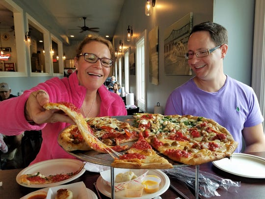 Nina Bambina and Todd Megar of Lolly's Pops enjoy pizza at Fetta in Owensboro. We were enchanted by the fun toppings (potato and bacon and the hot brown pizza are must-trys) and the airy-light garlic and jalapeno knot rolls.