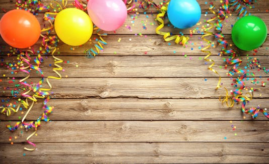 Balloons Streamers And Confetti On Rustic Wooden Board