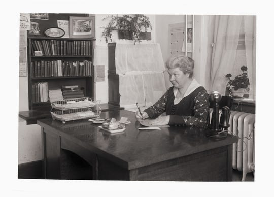 Margaret Durward, pictured at her desk in 1919, was the first female dean of Colorado Agricultural College's School of Agriculture.