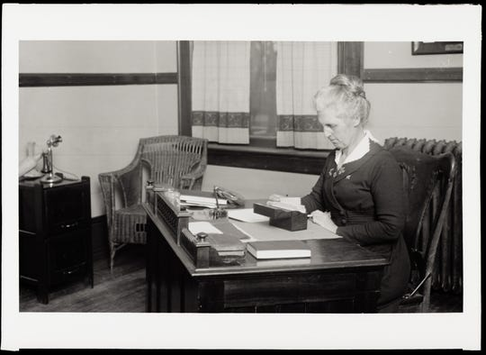 Virginia Corbett at her desk in 1919. Corbett was the Colorado Agricultural College's first dean of women and held the position for more than 20 years.
