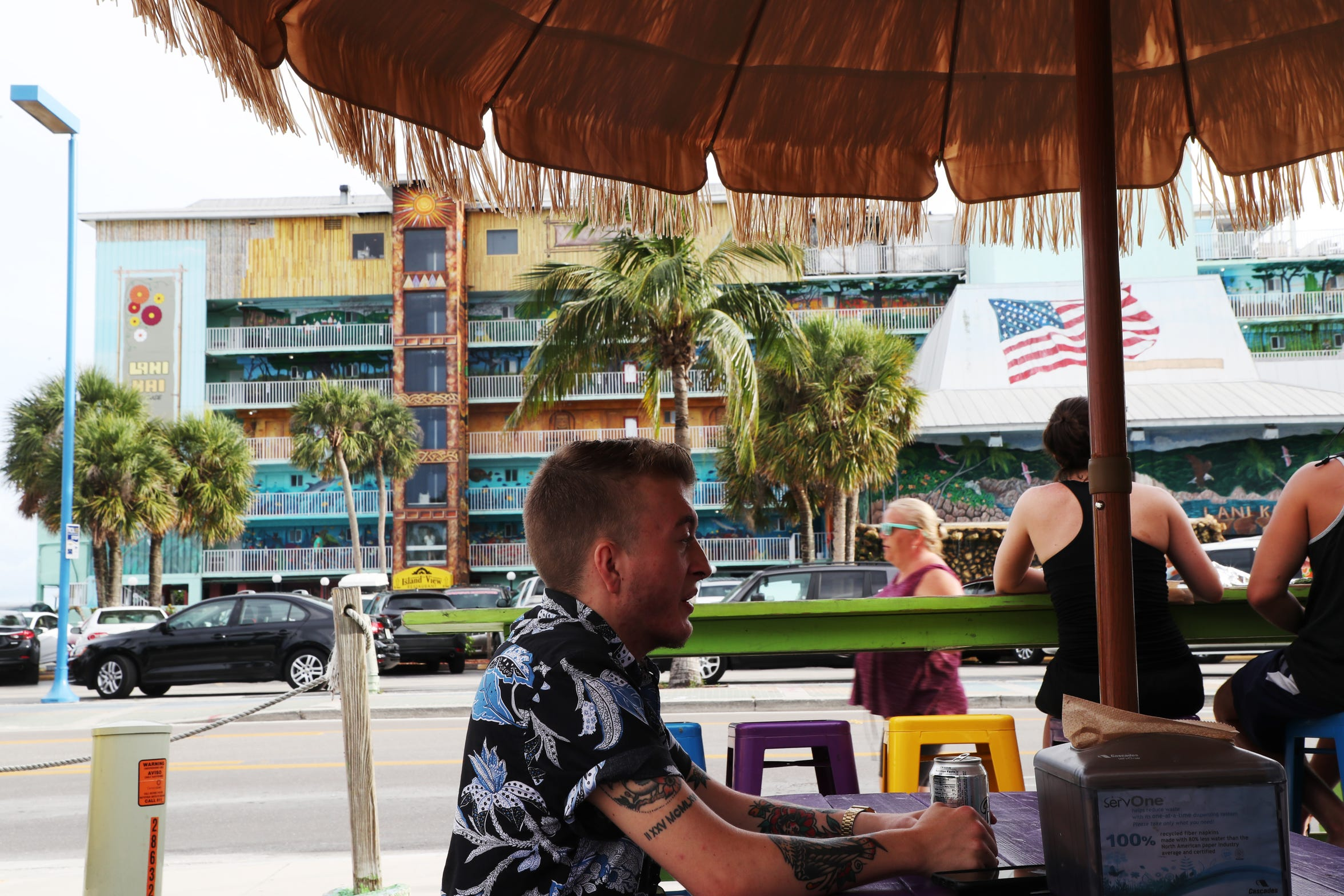 Kasey Fraize takes in a meal recently on Fort Myers Beach. Fraize struggled through middle and high school with his female identity, and at 15 he knew he wanted to transition but waited until college to avoid the hassles of parents, teachers and peers.