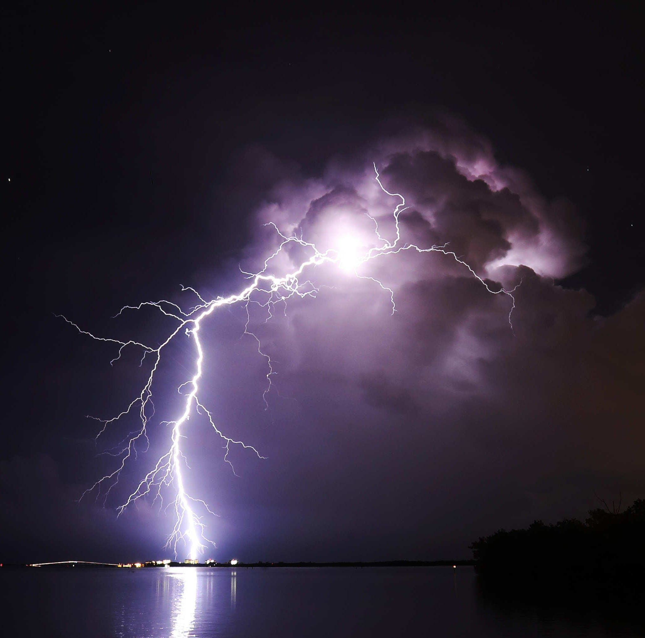 A bolt of lightning strikes near the Sanibel Causeway on Friday 8/10/2018. Photographed using a Canon 1DX with a 1250 ISO at 30 sec at f/10. Shot from a safe distance with a wide angle lens.