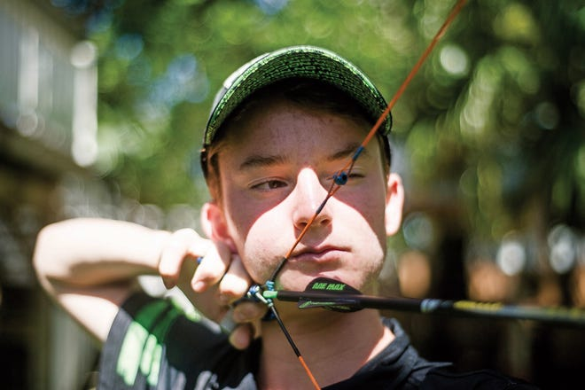 Tucker Hanks, of Naples, practices in his backyard prior to a national competition in June 2018.