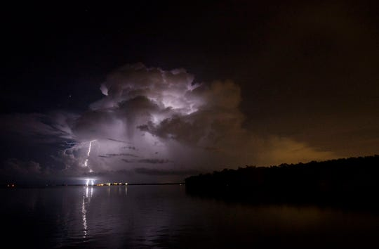 Bolts of lightning strike near the Sanibel Causeway on Friday 8/10/2018. Photographed using a Canon 1DX with a 1250 ISO at 30 sec at f/10. Shot from a safe distance with a wide angle lens.