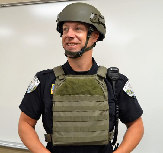 Oconto Falls Police Chief Brad Olsen  wears his helmet and rifle-rated protective vest provide through donations and grants coordinate through the Oconto County Law Enforcement Executive Group.