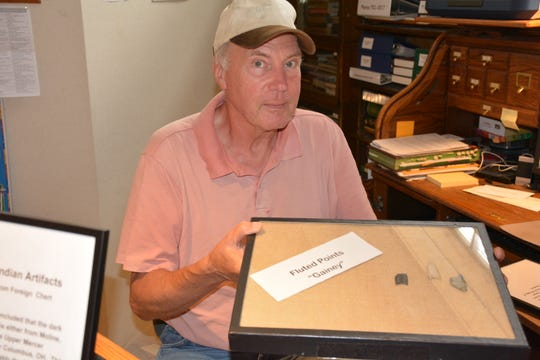 Bill Rice, assistant curator at Door County Historical Museum, holds a portion of the collection Darrel Cardy donated to the museum.