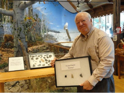 Darrel Cardy holds part of his collection at the Door County Historical Museum.