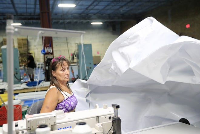 Linda Schroeder sews tent materials Monday at American Tent & Sidewall in Green Bay. The small business is feeling the effects of tariffs on aluminum and PVC. Adam Wesley/USA TODAY NETWORK-Wisconsin
