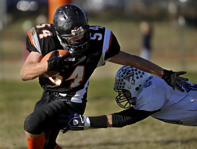 Chinook's Ben Stroh alludes a Power/Dutton-Brady tackler during a Class C playoff game in 2010.