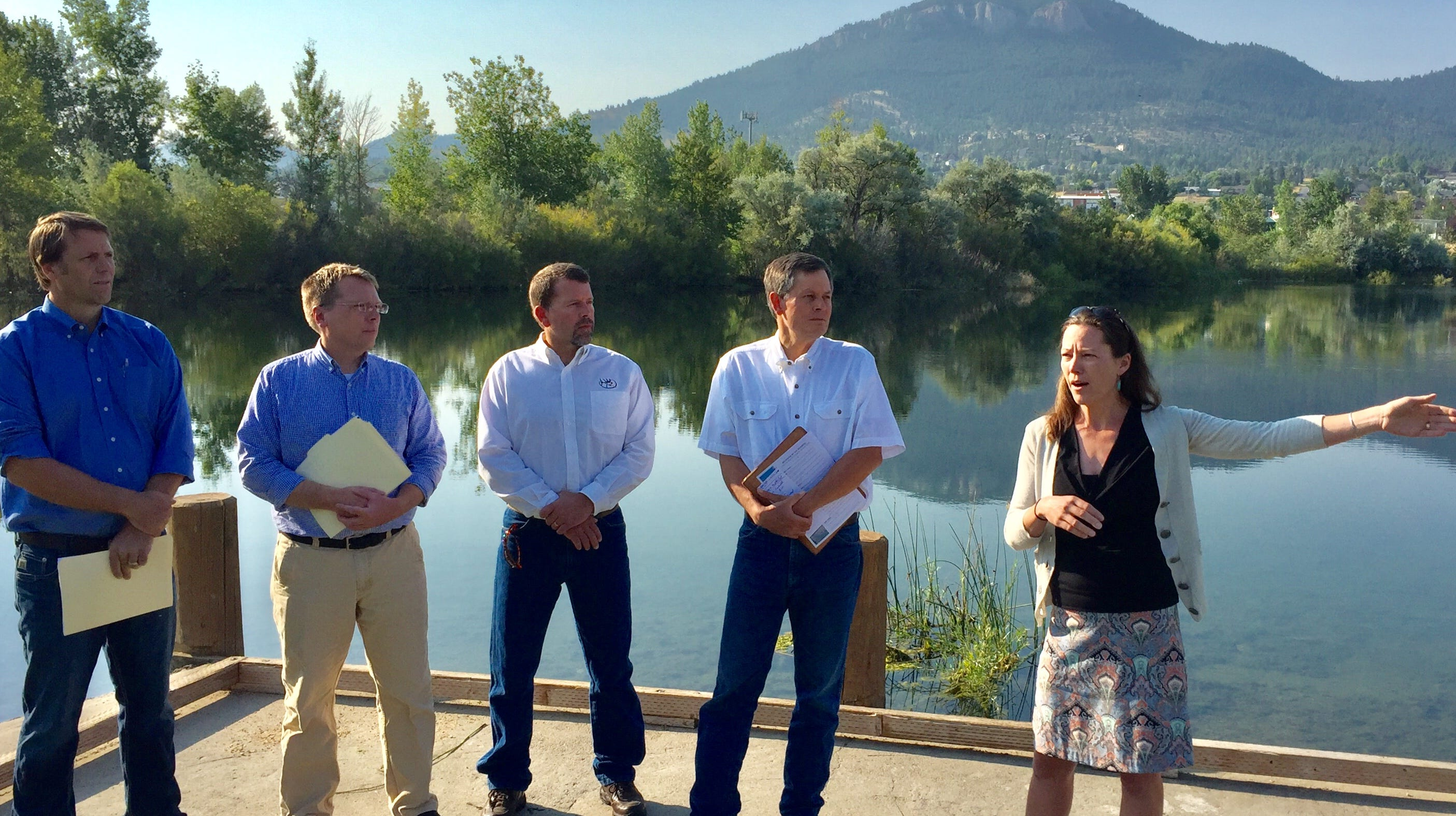 Sen. Steve Daines, second from right, listens Monday as Mary Hollow of the Prickly Pear Land Trust talks in Helena about the Land and Water Conservation Fund,
