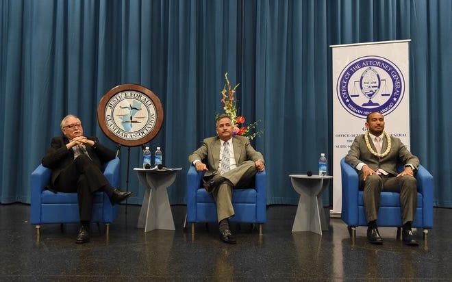 Attorney General candidates Gary W.F. Gumataotao, left, Douglas B. Moylan, center, and Leevin T. Camacho during the 2018 Attorney General Candidate Forum at the Guam Museum on Aug. 13, 2018.