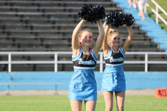 Emily Greenwell and Madi Hagan move to the beat during their performance.