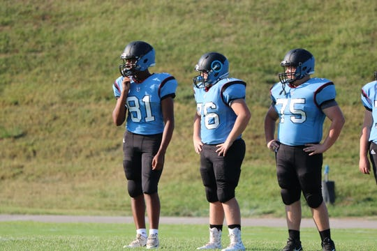 Iverson King, Jaden Hancock and Davis Pike stand ready for the scrimmage during their introductions at Meet the Braves.