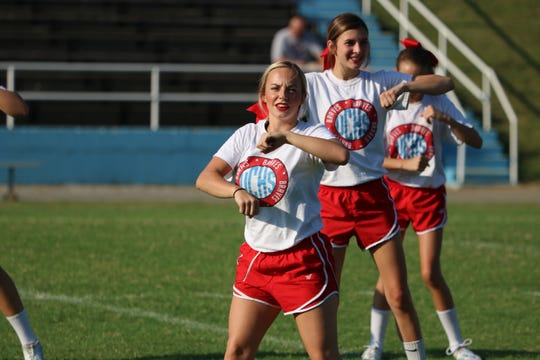 Kendall Wright (front) and Emma Sheffer (back) perform a dance for the cheer portion of Meet the Braves.