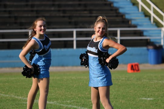 Emily Greenwell and Madi Hagan strike a pose during one of their dance moves at UCHS.