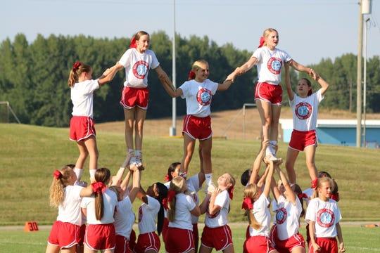 The UCHS cheerleaders finish their performance.