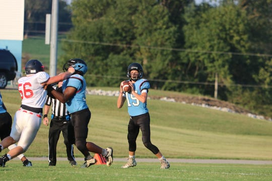 QB Solomon Teehan prepares a throw at the scrimmage on Friday night.