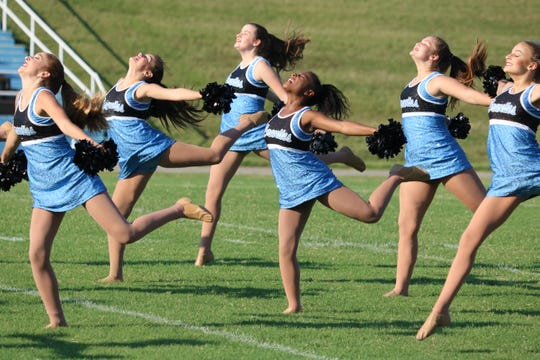 The girls take a leap during their performance at Meet the Braves.