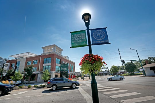 Downtown Fishers along 116th St. and Municipal Dr. is seen, Monday, August 6, 2018.  Downtown Fishers includes housing, government offices, and businesses.