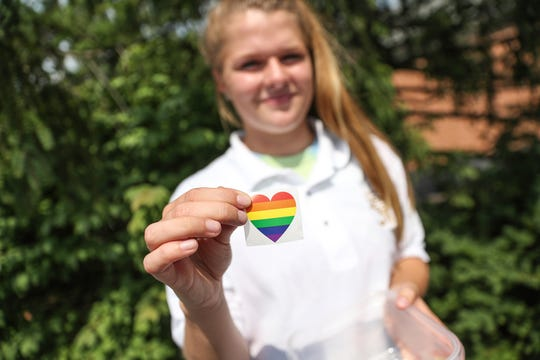 Madison Aldrich, a junior at Roncalli High School, shows a sticker that students and teachers wore to show support for guidance counselor, Shelly Fitzgerald, on Monday, Aug. 13, 2018. Fitzgerald was placed on paid administrative leave after school administrators found out she was married to a woman.