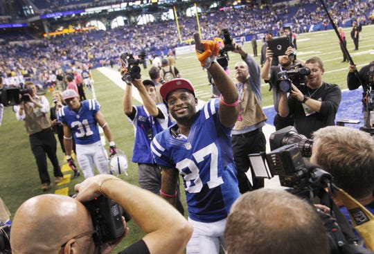 Colts receiver Reggie Wayne saluted fans cheering his name after he helped lead the Colts over the Packers 30-27.