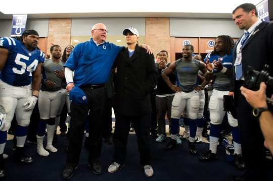 Indianapolis Colts interim head coach Bruce Arians, left, and head coach Chuck Pagano embrace in the locker room after the Colts defeated the Miami Dolphins 23-20 Nov. 4, 2012, at Lucas Oil Stadium. Matt Bowen/Indianapolis Colts