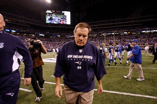 New England Patriots head coach Bill Belichick walks off the field after losing to the Colts in dramatic fashion on Nov. 15, 2009. (AP Photo/Nam Y. Huh)