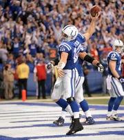Colts quarterback Andrew Luck spikes the ball after scoring a touchdown late in the second half of the 2014 AFC Playoff game against Kansas City. The Colts pulled out a 45-44 win.