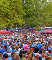 "Fans gather in The Grove to await the football team's ""Rebel Walk"" to the stadium before a game in 2017. The Grove, approximately 10 acres located in the middle of the Ole Miss campus in Oxford, is recognized as one of the nation's top tailgating sites."