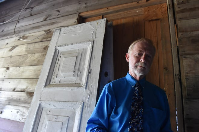 Investigative reporter Jerry Mitchell stands inside the shed where 14-year-old Emmett Till was killed on Aug. 28, 1955, by Roy Bryant, J.W. Milam and unknown assailants.