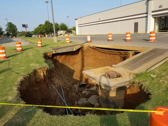 The cave-in between Target and Kroger was about 10 feet deep Sunday evening.