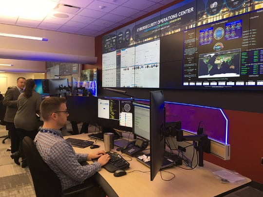 Beneath a giant wall screen displaying areas of potential concern in TVA's 7-state region, cyber security experts monitor a portion of the 2 billion activities across TVA's digital platforms every day at the downtown Chattanooga Office Complex. (Photo contributed by TVA)