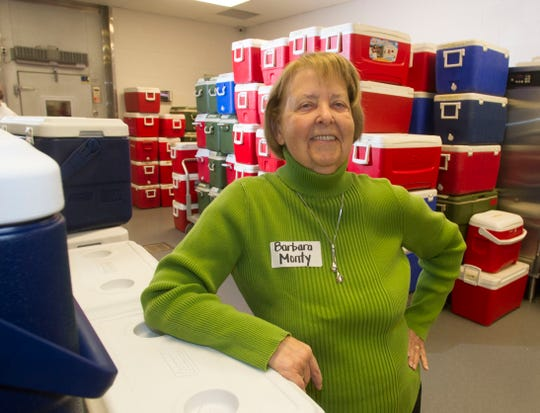 Barbara Monty in the staging area of Mobile Meals on Christmas Day December 25, 2012. Over a 170 volunteers helped deliver 500 Mobile Meals on Christmas Day. After picking up their meals and Christmas gifts the volunteers spread out across Knoxville to serve Mobile Meals Christmas Day.