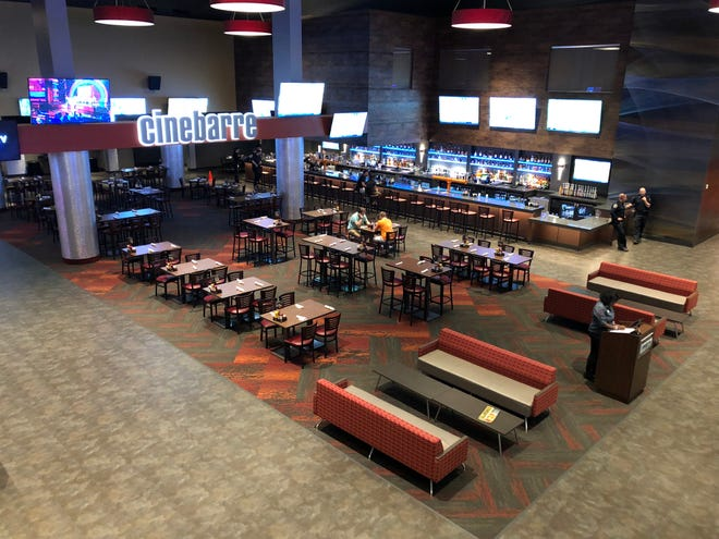Guests at Cinebarre can arrive 30 minutes ahead of showtime to order food and drinks from their theater seats or walk up to the lobby bar to place an order.