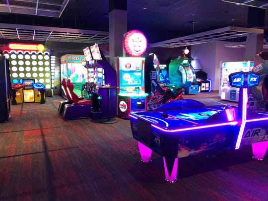 Shiny new arcade games, pool tables, plush couches and more fill the top and bottom floors at Cinebarre.