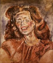 """It's unknown who the subject for this 1940s portrait of a redheaded woman is. It's one of several painted by Joseph Delaney and included in the Knoxville Museum of Art exhibit """"On the Move."""""""