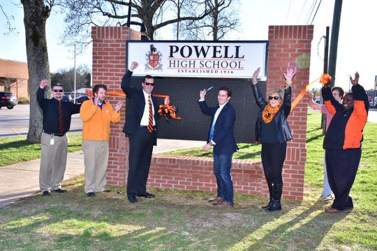 Powell High assistant principal/athletic director Chad Smith, left, celebrates the unveiling of the new digital sign at the school with teacher James Lee, principal Dr. Chad Smith, Justin Bailey, Patti Bounds, assistant prinicipal Amos Whitehead and student Christian Smithey (hidden from view), 2017.